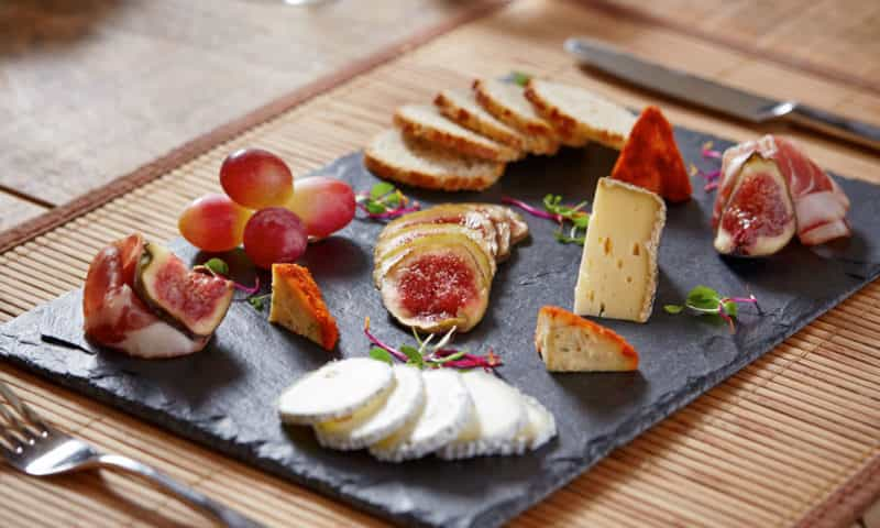 a great selection of cheeses with figs