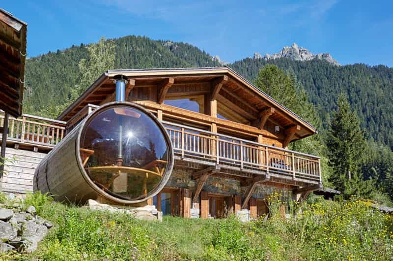 an outdoor sauna in the mountains