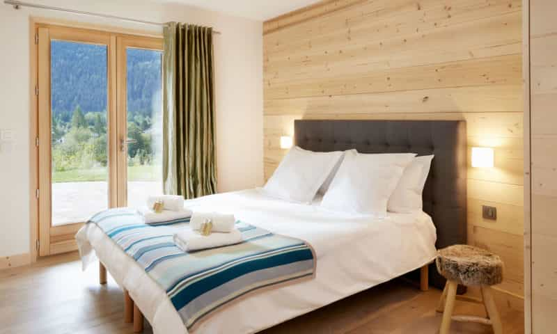 an elegant bedroom in a chalet