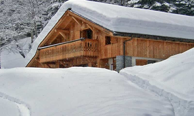an image of a ski chalet under the snow