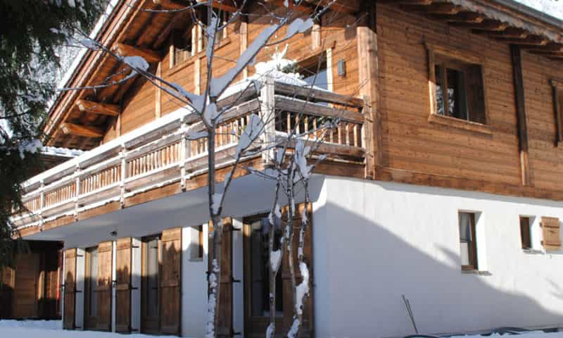 an image of a big ski chalet under the snow