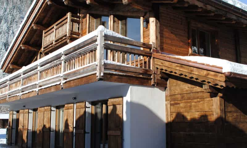 an image of a luxury ski chalet under the snow
