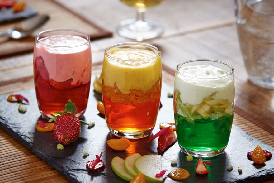image of three different coloured desserts