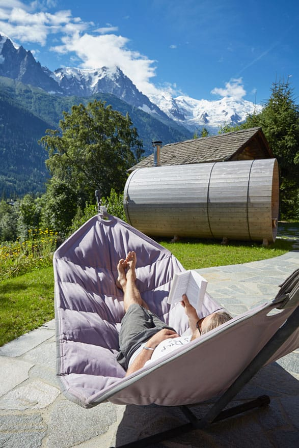 image of a person in hammock in front of mountain view