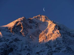 image of moon behind a mountain