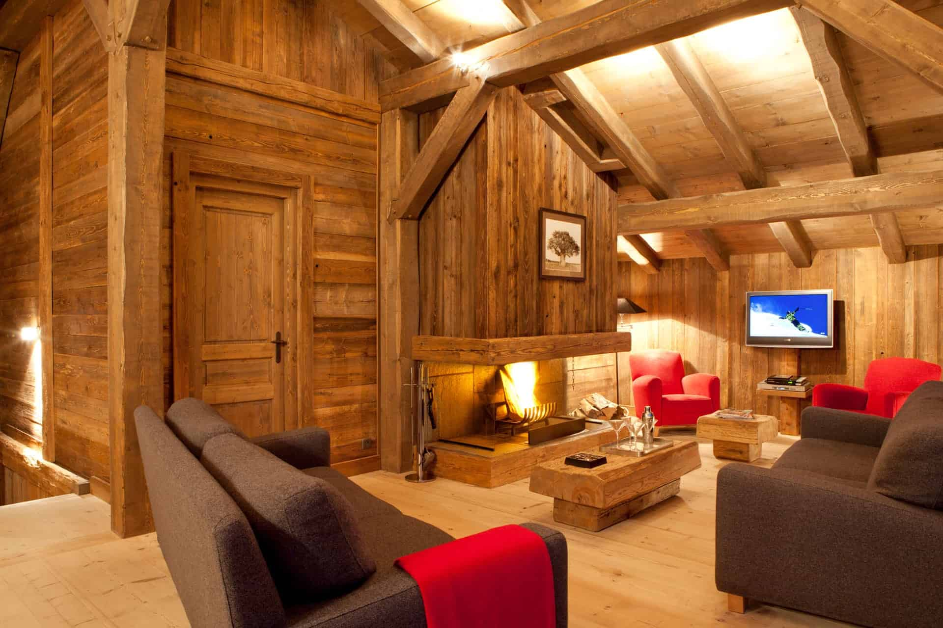 a cosy living room with a fire place