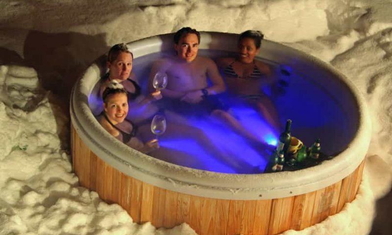 an outdoor hot tub with snow