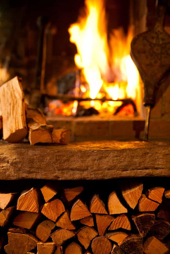 an open fireplace with wood