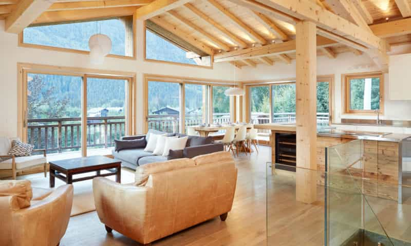 an elegant living room with mountain views