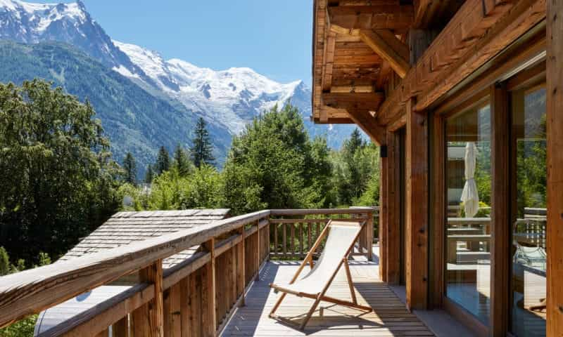 the balcony of a ski chalet