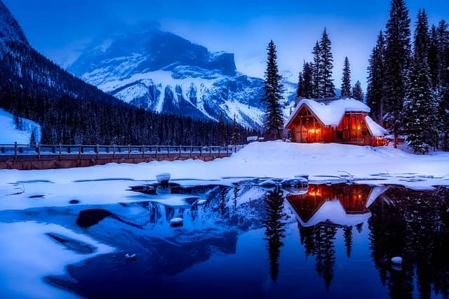 image of a cabin in snow